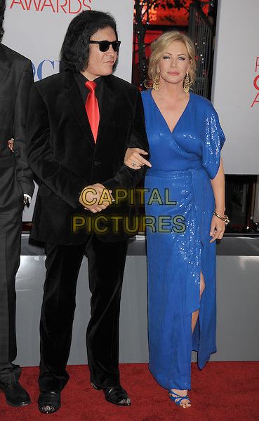 Gene Simmons, Shannon Tweed.People's Choice Awards 2012 held at Nokia Live in Los Angeles, California, USA..January 11th, 2012.full length black suit sunglasses shades blue dress .CAP/ROT/TM.©Tony Michaels/Roth Stock/Capital Pictures
