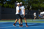 Petros Chrysochos (left) of the Wake Forest Demon Deacons shakes hands with doubles partner Bar Botzer after winning their match against the Ohio State Buckeyes during the 2018 NCAA Men's Tennis Championship at the Wake Forest Tennis Center on May 22, 2018 in Winston-Salem, North Carolina. (Brian Westerholt/Sports On Film)