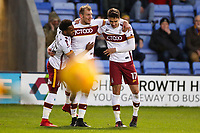 Tyrell Robinson, Charlie Wyke and Alex Gilliead of Bradford City celebrate the only goal of the game during the Sky Bet League 1 match between Shrewsbury Town and Bradford City at Greenhous Meadow, Shrewsbury, England on 25 November 2017. Photo by Thomas Gadd.