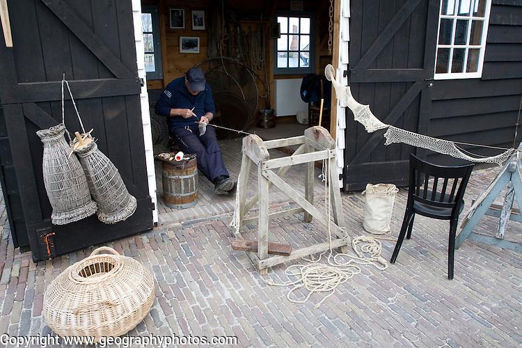 Fisherman mending nets Zuiderzee museum, Enkhuizen, Netherlands