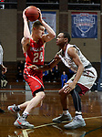 SIOUX FALLS, SD - MARCH 12:  Kyle Mangas #24 from Indiana Wesleyan looks to make a move against Jaylen McKay #11 from IU East during their semifinal game at the 2018 NAIA DII Men's Basketball Championship at the Sanford Pentagon in Sioux Falls. (Photo by Dave Eggen/Inertia)