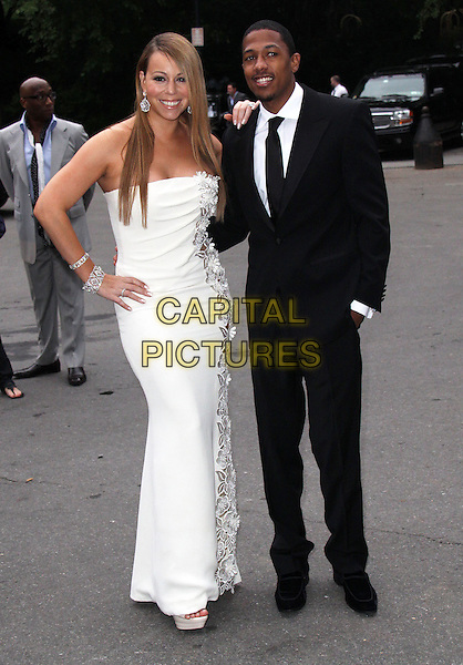 MARIAH CAREY & NICK CANNON.2009 Fresh Air Fund Salute To American Heroes held at Tavern On The Green, New York, NY, USA..June 4th, 2009.full length white strapless dress floral flowers pattern black suit hand on hip around waist married husband wife in pocket bracelets.CAP/ADM/PZ.©Paul Zimmerman/AdMedia/Capital Pictures.