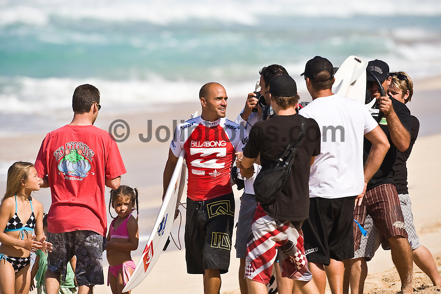 KELLY SLATER (USA) congratulates JOEL PARKINSON (AUS)  on scoring two perfect 10 point rides in his heat of the Billabong Pipeline Masters today Wednesday December 10, 2008. Slater and Parkinson are the only two surfers in ASP history to share perfect 20 point heat score. SHANE BESCHEN (HAW)  scored a perfect 30 point heat score when the surfers were judged on three rides. The Billabong Pipeline Masters is the last event on the 2008  ASP World Championship Tour with US$320.000 total prize purse. The event has a waiting period from December 8-20 2008. Pipeline on the North Shore of Oahu, Hawaii is the location for this prestigious event. Photo: joliphotos.com