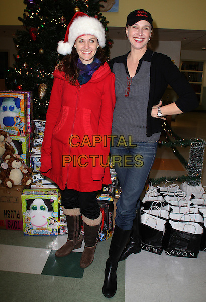 "AMY BRENNEMAN & BRENDA STRONG .""The Salvation Army"" Making Miracle on South Central, Sponsored by Feed The Children and NBPA held at Salvation Army Headquarters,  Los Angeles, CA, USA,  13 December 2008..full length red santa hat xmas christmas coat cap hat grey gray top jeans black knee high boots .CAP/ADM/KB.©Kevan Brooks/Admedia/Capital PIctures"