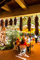 Diners eating on an outdoor patio, El Pinto Restaurant and Cantina, Albuquerque, New Mexico USA