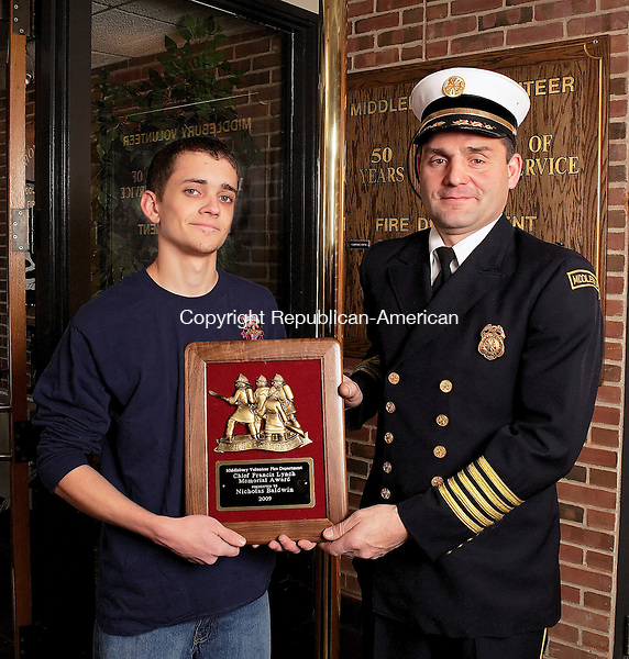 "Middlebury, CT-31, December 2009-123109CM03 -- Middlebury Fire Department's Chief Paul Perrotti (right) stands with Nick Baldwin, 18, of Middlebury . Baldwin was recently awarded the Chief Francis Lynch Memorial Award, aka ""good kid award.""  Baldwin, a 4th generation firefighter.  The award is presented to a young standout member of the department each year.  Christopher Massa Republican-American"