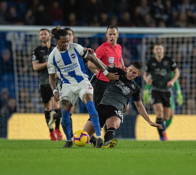 Brighton &amp; Hove Albion's Gaetan Bong (left) is tackled by Burnley's Ashley Westwood (right) <br /> <br /> Photographer David Horton/CameraSport<br /> <br /> The Premier League - Brighton and Hove Albion v Burnley - Saturday 9th February 2019 - The Amex Stadium - Brighton<br /> <br /> World Copyright &copy; 2019 CameraSport. All rights reserved. 43 Linden Ave. Countesthorpe. Leicester. England. LE8 5PG - Tel: +44 (0) 116 277 4147 - admin@camerasport.com - www.camerasport.com
