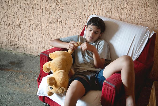 Cantavir, Vojvodina, Serbien, 02.07.2009: Andor ist der Aelteste von drei Geschwistern. Mit elf Jahren hat er die Schule verlassen und verbringt seitdem die meiste Zeit zu Hause.<br /> <br /> <br />Cantavir, Vojvodina, Serbia, 02.07.2009: Andor is the oldest of three siblings. At age eleven, he left school and since then he spends most of the time at home.