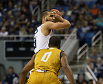 Nevada forward forward Caleb Martin (10) looks to pass over California Baptist guard Milan Acquaah (0) in the second half of an NCAA college basketball game in Reno, Nev., Monday, Nov. 19, 2018. (AP Photo/Tom R. Smedes)