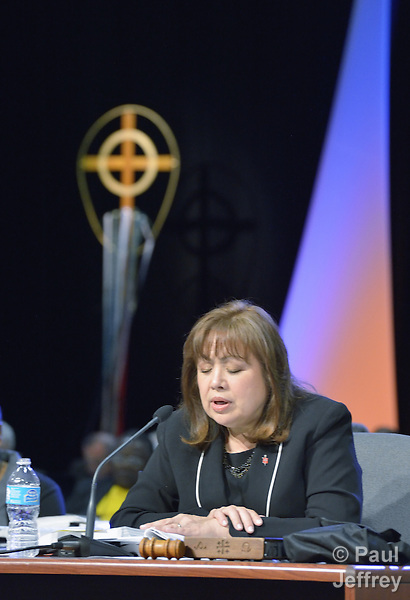 At the 2012 United Methodist General Conference in Tampa, Florida, Bishop Minerva Carcaño of Phoenix prays before a May 1 vote on retaining guaranteed appointments for clergy. The guarantee of an annual appointment was eliminated by the conference.