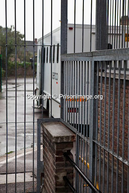 A prison van waiting outside a magistrate court to take prisoners back to prison after their court hearings.