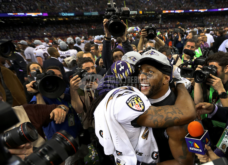 Feb 3, 2013; New Orleans, LA, USA; Baltimore Ravens inside linebacker Ray Lewis (facing forward) hugs wide receiver Torrey Smith after defeating the San Francisco 49ers in Super Bowl XLVII at the Mercedes-Benz Superdome. Mandatory Credit: Mark J. Rebilas-