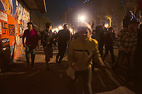 EGYPT / Cairo / 24.11.2012 / Protesters run in Kasr Al Ainy Street after Central Security Forces (CSF) have thrown tear gas. Protesters have gathered against president Morsi's decree © Giulia Marchi