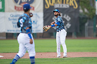 Ogden Raptors shortstop Ronny Brito (5) prepares to throw a ball to Kenneth Betancourt (9) during a Pioneer League game against the Billings Mustangs at Lindquist Field on August 17, 2018 in Ogden, Utah. The Billings Mustangs defeated the Ogden Raptors by a score of 6-3. (Zachary Lucy/Four Seam Images)