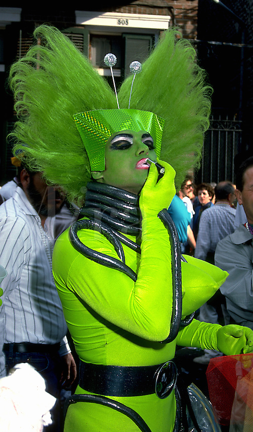 A Mardi Gras parade participant in a colorful Green Goddess costume. New Orleans, Louisiana.