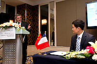 GDF Suez CEO and Paris Europlace Chairman Gerard Mestrallet (left) points to Shanghai Office of Financial Services Director-General Fang Xinghai, at the signature ceremony of a Memorandum of Understanding between Paris Europlace and Shanghai Financial Services, at Shanghai / Paris Europlace Financial Forum, in Shanghai, China, on December 1, 2010. Photo by Lucas Schifres/Pictobank