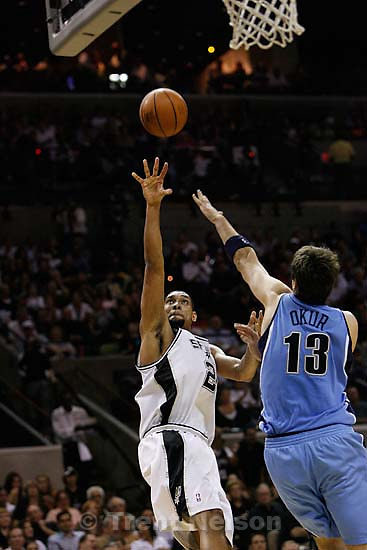 San Antonio - San Antonio Spurs forward Tim Duncan  (21) shooting over Utah Jazz center Mehmet Okur (13). Utah Jazz vs. San Antonio Spurs, Western Conference Finals game five at the AT&T Center..5.30.2007