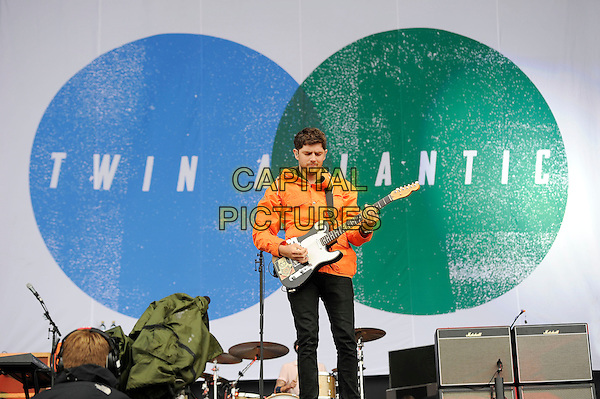 Sam McTrusty of Twin Atlantic<br /> performing on the Main stage, Reading Festival, Reading, England. 24th August 2013.<br /> music concert gig live on stage half length orange  jacket playing anorak guitar <br /> CAP/MAR<br /> &copy; Martin Harris/Capital Pictures
