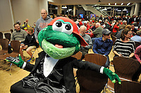 Mascot Reedy Rip'It of the Greenville Drive, wearing a tuxedo, waits for the start of the annual Hot Stove Event on Tuesday, January 26, 2016, in the ONE Building in Downtown Greenville, South Carolina. Boston Red Sox General Manager Mike Hazen and Greenville Drive Manager Darren Fenster attended. (Tom Priddy/Four Seam Images)