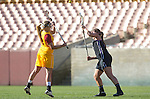 Los Angeles, CA 02/09/13 - Kaila Sommi (USC #12) and Alyssa Leonard  (Northwestern #2) in action during the Northwestern vs USC NCAA Women Lacrosse game at the Los Angeles Colliseum.