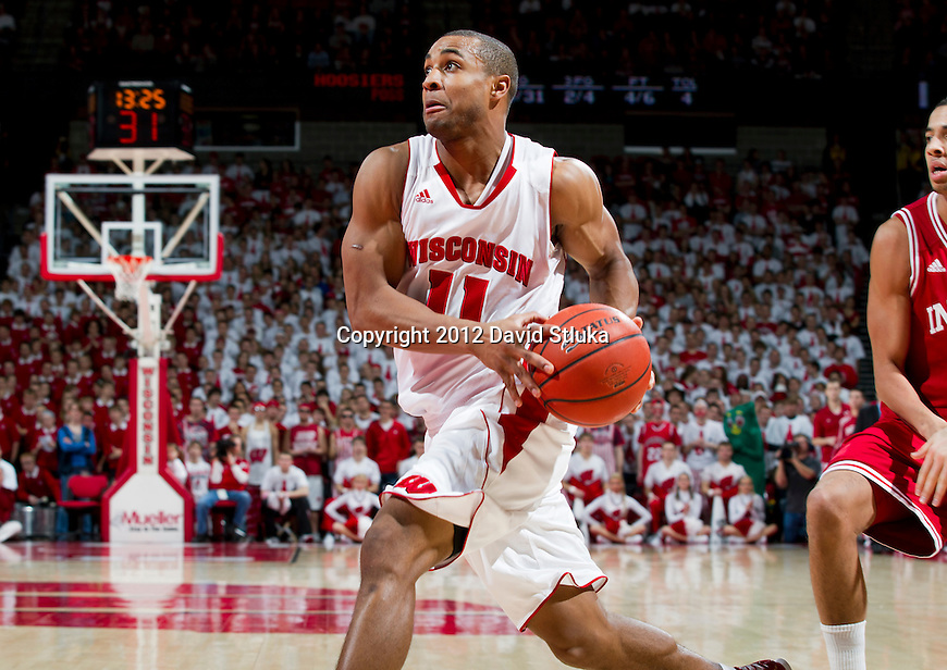 Wisconsin Badgers guard Jordan Taylor (11) drives to the hoop during a Big Ten Conference NCAA college basketball game against the Indiana Hoosiers on January 26, 2012 in Madison, Wisconsin. The Badgers won 57-50. (Photo by David Stluka)