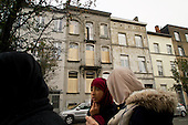 A boarded up house in Molenbeek, Brussels, believed to be where Paris attack suspect Saleh Abdeslam was hiding. The door was destroyed by police action. <br /> <br /> Molenbeek neighbourhood is a hotbed of Islamic fundamentalism.