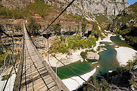 Simple suspension bridge above the river Tara, Montenegro, Europe