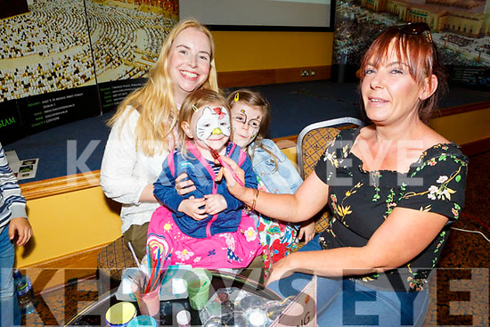 Alva Falvey having her face painted by Catherine Fitzmaurice at the Islamic Exhibition in the Brandon Hotel on Saturday, pictured with her sister Orla and mom Anne Marie Fuller