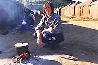 Kosovar Albanian refugee woman cooks dinner in a refugee camp in Macedonia