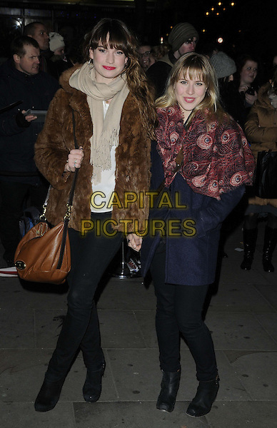 Lily James & guest.The English National Ballet - Nutcracker pre-show reception, St Martins Lane Hotel, St Martin's Lane, London, England..December 13th, 2012.full length black trousers beige scarf red pattern print scarf blue coat tights brown bag purse fur jacket   .CAP/CAN.©Can Nguyen/Capital Pictures.