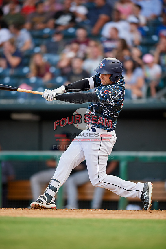 Jacksonville Jumbo Shrimp designated hitter Eric Jagielo (25) follows through on a swing during a game against the Mobile BayBears on April 14, 2018 at Baseball Grounds of Jacksonville in Jacksonville, Florida.  Mobile defeated Jacksonville 13-3.  (Mike Janes/Four Seam Images)