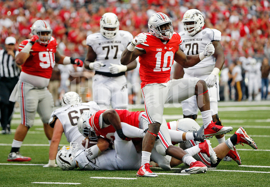 Ohio State Buckeyes defensive lineman Jalyn Holmes (10) celebrates a tackle against the Western Michigan Broncos offense in the 3rd quarter of their game at Ohio Stadium on September 26, 2015.  (Dispatch photo by Kyle Robertson)