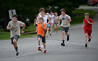 Members of the West Fork cross country team near the finish line Friday, July 31, 2020, during practice at West Fork Elementary School. The team ran relay drills while observing social-distancing requirements. Visit nwaonline.com/200801Daily/ for today's photo gallery.<br /> (NWA Democrat-Gazette/Andy Shupe)