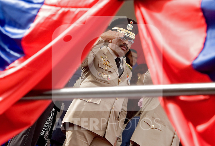 "A Venezuelan military officer watches a military parade in Valencia, Venezuela, on Saturday, June 24, 2006. The military parade was to celebrate Army Day and took place in ""Campo de Carabobo"", the field where the last big battle for the Venezuelan independence was won. (ALTERPHOTOS/Alvaro Hernandez)."