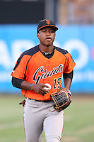 Jalen Miller (15) of the AZL Giants returns to the dugout after warming up the right fielder during a game against the AZL Angels at Tempe Diablo Stadium on July 6, 2015 in Tempe, Arizona. Angels defeated Giants, 3-1. (Larry Goren/Four Seam Images)