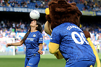 Chelsea mascot, Stamford takes a close look at the freestyler entertaining the fans at half-time during Chelsea Women vs Tottenham Hotspur Women, Barclays FA Women's Super League Football at Stamford Bridge on 8th September 2019