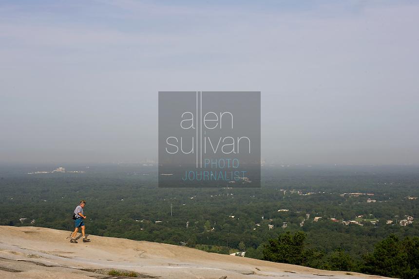 A walker on top of Stone Mountain in Stone Mountain, Georgia.