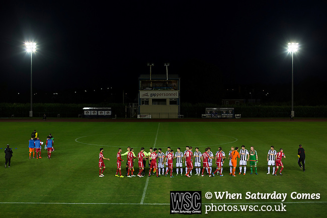 Connah's Quay Nomads 1 Llandudno 1, 20/09/2016. Deeside Stadium, Welsh Premier League. The teams exchanging handshakes on the pitch at the Deeside Stadium before Connah's Quay Nomads (in red) played Llandudno in a Welsh Premier League match. Both clubs represented Wales in the 2016-17 Europa League, the first time either had competed in European competition. The match ended in a 1-1 draw, watched by 181 spectators. Photo by Colin McPherson.