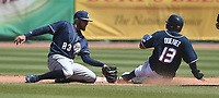 NWA Democrat-Gazette/J.T. WAMPLER Naturals' Samir Duenez slides into second base while San Antonio's Fernandez Tatis Jr. tries to make the tag Tuesday April 10, 2018 at Arvest Ballpark in Springdale. The Naturals won 4-0.