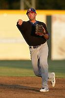 Stockton Ports second baseman Michael Gilmartin #3 makes a throw against the Visalia Rawhide at Recreation Park on July 30, 2011 in Visalia,California. Visalia defeated Stockton 11-2.(Larry Goren/Four Seam Images)