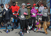NWA Democrat-Gazette/DAVID GOTTSCHALK Bundled up runners leave the starting line Monday, January 1, 2017, at the beginning of the 4th Annual Black Eyed Pea New Year's Day Run to run either the 5k or 10K course in Fayetteville. The race, organized by Doug and Pauline Allen, is free with all donations acquired going to the Fayetteville High School Cross Country teams. Snacks at the race included black eyed peas and cornbread.