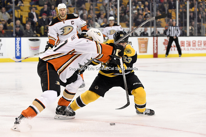 Tuesday, January 26, 2016: Boston Bruins left wing Brad Marchand (63) and Anaheim Ducks defenseman Hampus Lindholm (47) battle for the puck during the National Hockey League game between the Anaheim Ducks and the Boston Bruins, held at TD Garden, in Boston, Massachusetts. Anaheim defeats Boston 6-2. Anaheim defeats Boston 6-2. Eric Canha/CSM