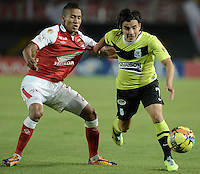 BOGOTÁ -COLOMBIA, 28-11-2013. Francisco Meza (I) de Independiente Santa Fe disputa el balón con Sherman Cardenas (D) del Atlético Nacional durante partido por la fecha 1 de los cuadrangulares finales de la Liga Postobón  II 2013 jugado en el estadio Nemesio Camacho el Campín de la ciudad de Bogotá./ Independiente Santa Fe player Francisco Meza (L) fights for the ball with Atletico Nacional player Sherman Cardenas (R) during match for the first date of final quadrangulars of the Postobon  League II 2013 played at Nemesio Camacho El Campin stadium in Bogotá city. Photo: VizzorImage/ Gabriel Aponte /