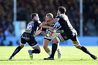 Tom Homer of Bath Rugby is double-tackled by Joe Simmonds and Dave Dennis of Exeter Chiefs. Gallagher Premiership match, between Exeter Chiefs and Bath Rugby on March 24, 2019 at Sandy Park in Exeter, England. Photo by: Patrick Khachfe / Onside Images