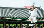 """Dano Festival, June 9, 2016 : Kim Dae-gyun, tightrope walking master and the Important Intangible Cultural Property No. 58 of South Korea, performs during """"Early Summer High Day, Dano Festival"""" at the Namsangol Hanok Village in Seoul, South Korea. (Photo by Lee Jae-Won/AFLO) (SOUTH KOREA)"""