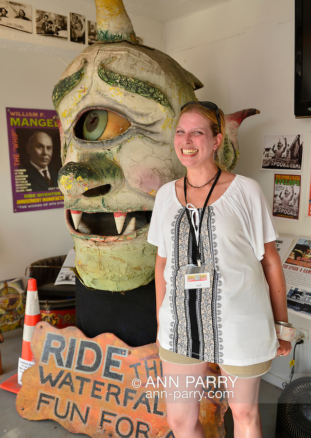 Brooklyn; New York; U.S. - August 9; 2014 - JENNIFER GARLAND, a volunteer historian at the Coney Island History Project, is next to Spook-A-Rama Cyclops at The Fourth Annual History Day at Deno's Wonder Wheel Amusement Park.
