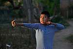 A Wichi indigenous boy shoots a slingshot in Embarcacion, Argentina. The Wichi in this area, largely traditional hunters and gatherers, have struggled for decades to recover land that has been systematically stolen from them by cattleraisers and large agricultural plantations.