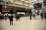 People on the concourse with train departures displayed, Waterloo station, London