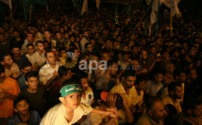 Hundreds of Palestinian supporters of the Islamist movement Hamas raise their arms and chant slogans during a rally in support of sacked prime minister Ismail Haniya in Gaza City. The Israeli military killed six Palestinian militants today as they were preparing to launch an attack against an army post on the Gaza border, sources on both sides said