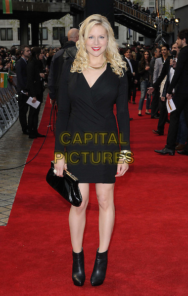Abi Titmuss.'The Dictator' world film premiere, Royal Festival Hall, London, England. .10th May 2012.full length black dress ankle boots clutch bag.CAP/CAN.©Can Nguyen/Capital Pictures.